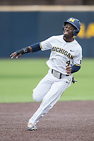 Michigan Wolverines second baseman Ako Thomas (4) runs to third base against the Indiana Hoosiers during the NCAA baseball game on April 21, 2017 at Ray Fisher Stadium in Ann Arbor, Michigan. Indiana defeated Michigan 1-0. (Andrew Woolley/Four Seam Images)