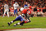 UK cornerback Trevard Lindley attempts to stop Georgia wide receiver Rantavious Wooten from making a touchdown during the Cats' game against Georgia on Saturday, Nov. 21, 2009 at Sanford Stadium in Athens, Ga. The Cats were behind the Bulldogs 20-6 at the half.