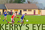 The Bernard O'Callaghan Memorial Senior Football Championship 2014 Quarter Final Brosna V St. Senan's, sponsored by McMunns Ballybunion, Saturday November 29th 2014. Held in Duagh. <br /> <br /> St. Senan's Sean O'Connell being chased down by Brosna's Dave Curtin.