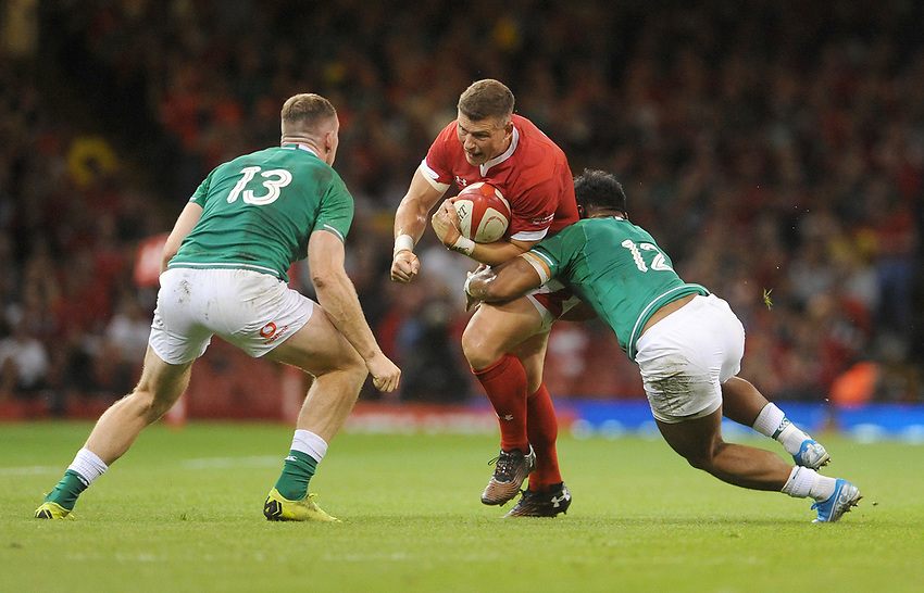 Wales Scott Williams is tackled by Ireland's Bundee Aki<br /> <br /> Photographer Ian Cook/CameraSport<br /> <br /> 2019 Under Armour Summer Series - Wales v Ireland - Saturday 31st August 2019 - Principality Stadium - Cardifff<br /> <br /> World Copyright © 2019 CameraSport. All rights reserved. 43 Linden Ave. Countesthorpe. Leicester. England. LE8 5PG - Tel: +44 (0) 116 277 4147 - admin@camerasport.com - www.camerasport.com
