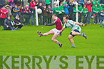 A great point from play for Dromid's Niall O'Shea as Kanturk's Eoin O'Connor gives chase.