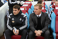 Sunday 07 December 2014<br /> Pictured L-R: Swansea coach Josep Clotet and manager Garry Monk<br /> Re: Premier League West Ham United v Swansea City FC at Boleyn Ground, London, UK.