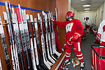 Wisconsin Badgers women's hockey player grabs a stick in the new locker room on move-in day at the LaBahn Arena Monday, October 1, 2012 in Madison, Wisc. (Photo by David Stluka)