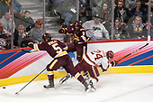 Nick Wolff (UMD - 5), Colin Staub (DU - 24), Dan Molenaar (UMD -3) - The University of Denver Pioneers defeated the University of Minnesota Duluth Bulldogs 3-2 to win the national championship on Saturday, April 8, 2017, at the United Center in Chicago, Illinois.