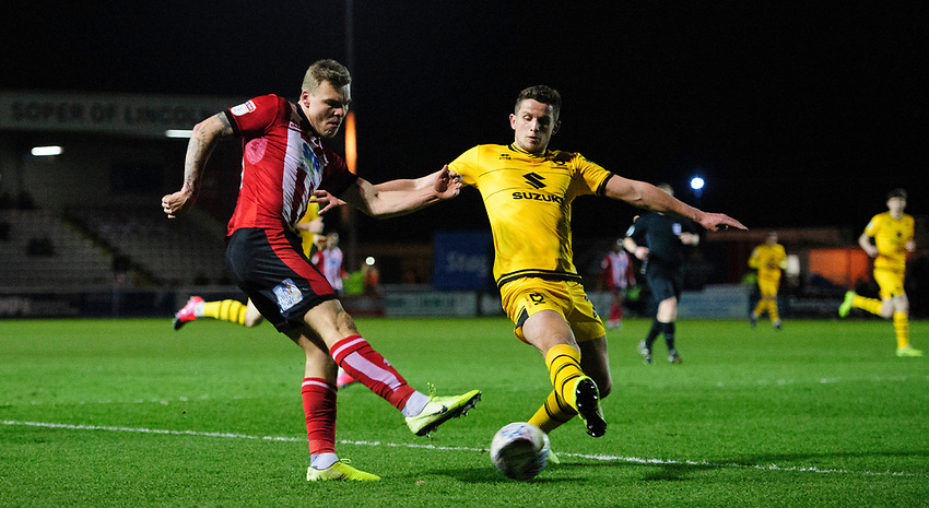 Lincoln City's Harry Anderson vies for possession with Milton Keynes Dons' Jordan Houghton<br /> <br /> Photographer Chris Vaughan/CameraSport<br /> <br /> The EFL Sky Bet League One - Lincoln City v Milton Keynes Dons - Tuesday 11th February 2020 - LNER Stadium - Lincoln<br /> <br /> World Copyright © 2020 CameraSport. All rights reserved. 43 Linden Ave. Countesthorpe. Leicester. England. LE8 5PG - Tel: +44 (0) 116 277 4147 - admin@camerasport.com - www.camerasport.com