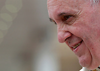 Papa Francesco sorride al termine dell'udienza generale del mercoledi' in Piazza San Pietro, Citta' del Vaticano, 23 aprile 2014.<br /> Pope Francis smiles as he leaves at the end of his weekly general audience in St. Peter's Square at the Vatican, 23 April 2014.<br /> UPDATE IMAGES PRESS/Isabella Bonotto<br /> <br /> STRICTLY ONLY FOR EDITORIAL USE
