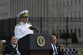Arlington, VA - September 11, 2008 -- Chairman of the Joint Chiefs of Staff Navy Adm. Mike Mullen speaks at the Pentagon Memorial dedication ceremony Sept. 11, 2008. The national memorial is the first to be dedicated to those killed at the Pentagon on Sept. 11, 2001. The site contains 184 inscribed memorial units honoring the 59 people aboard American Airlines Flight 77 and the 125 in the building who lost their lives that day. .Credit: Chad McNeeley - DoD via CNP