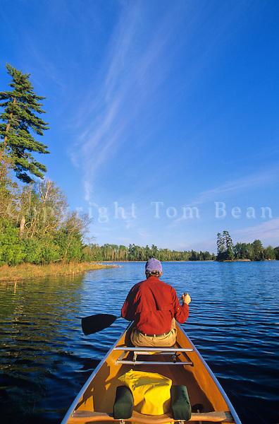 Man paddling canoe on quiet lake, Swanson's Bay, Sand Point Lake, Voyageurs National Park, Minnesota, AGPix_0538..