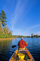 Man paddling canoe on quiet lake, Swanson's Bay, Sand Point Lake, Voyageurs National Park, Minnesota, AGPix_0538..