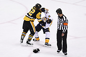 8th June 2017, Pittsburgh, PA, USA; Nashville Predators right wing Viktor Arvidsson (38) and Pittsburgh Penguins left wing Carl Hagelin (62) scrum as referee Wes McCauley (4) looks on during the third period. Game Five was won 6-0 by the Pittsburgh Penguins against the Nashville Predators during the 2017 NHL Stanley Cup Final on June 8, 2017, at PPG Paints Arena in Pittsburgh, PA. The Penguins take a 3-2 series lead in the best of seven series with the victory.