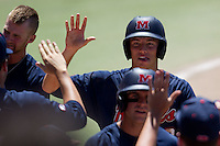 Second baseman Alex Yarbrough #2 of the Ole Miss Rebels celebrates with his teammates during the NCAA Regional baseball game against the Texas Christian University Horned Frogs on June 1, 2012 at Blue Bell Park in College Station, Texas. Ole Miss defeated TCU 6-2. (Andrew Woolley/Four Seam Images).