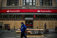 NEW YORK, NEW YORK - JUNE 1: A Bank is boarded up on June 1, 2020 in New York. The protests spread across the country in at least 30 cities across the United States, over the death of unarmed black man George Floyd at the hands of a police officer, this is the latest death in a series of police deaths of black Americans. Today is the first night of a curfew in New York City (Photo by Pablo Monsalve / VIEWpress via Getty Images)