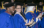 Graduates snap selfies during the DePaul University College of Computing and Digital Media and the College of Communication hold their commencement ceremony at the Allstate Arena in Rosemont, IL. (DePaul University/Jamie Moncrief)