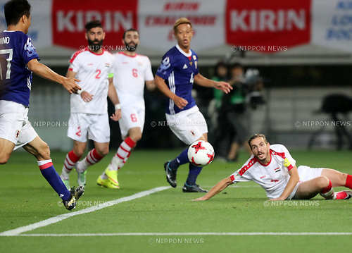 June 7, 2017, Tokyo, Japan - Japan's Yasuyuki Konno (L) shoots the ball to score a goal against Syria during a friendly match between Japan and Syria Kirin Challenge Cup in Tokyo on Wednesday, June 7, 2017. Japan and Syria drew the game 1-1.  (Photo by Yoshio Tsunoda/AFLO) LwX -ytd-