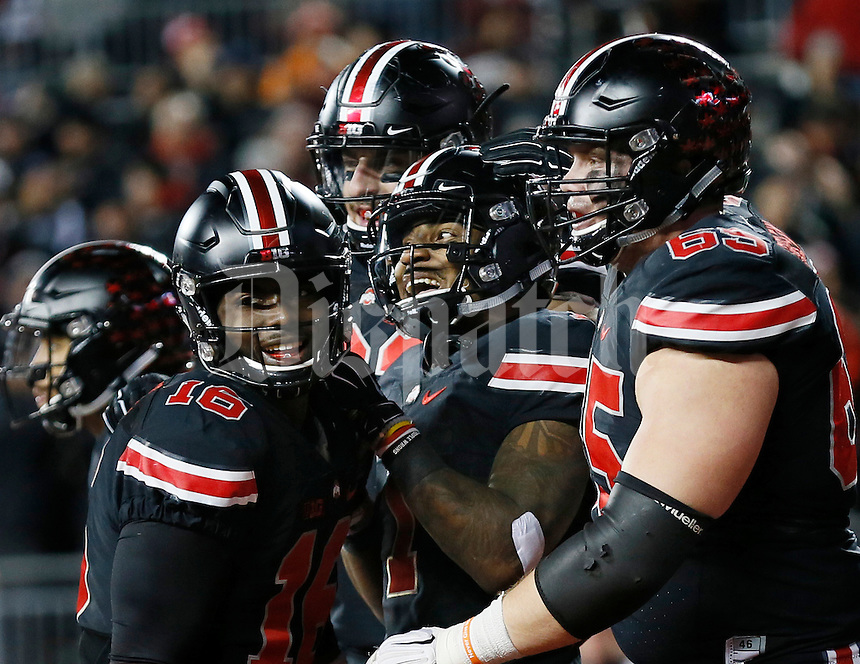Ohio State Buckeyes wide receiver Braxton Miller (1), middle, celebrates a touchdown catch during the fourth quarter of the NCAA football game against the Penn State Nittany Lions at Ohio Stadium in Columbus on Oct. 17, 2015. Ohio State won 38-10. (Adam Cairns / The Columbus Dispatch)