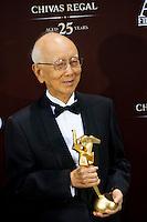 HONG KONG - MARCH 21:  Hong Kong producer Raymond Chow poses backstage after winning the Lifetime Achievement Award during the 5th Asia Film Awards ceremony at the Convention and Exhibition Centre on March 21, 2011 in Hong Kong, China.  Photo by Victor Fraile / studioEAST