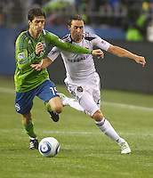 Seattle Sounders FC forward Alvaro Fernandez battles L.A. Galaxy defender Todd Dunivant during play between the Seattle Sounders FC and the L.A. Galaxy at Qwest Field in Seattle Tuesday March 15, 2011. The Galaxy won the game 1-0.