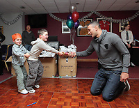 Pictured:  Stephen Caulker (R) pulls a Christmas cracker with two young supporters. Thursday 15 December 2011<br />