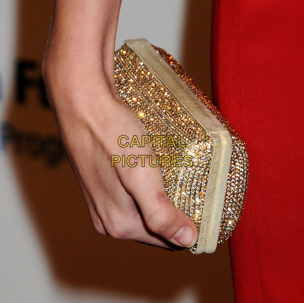 TAYLOR SWIFT's clutch.EIF's Women's Cancer Research Fund Benefit held at the Beverly Wilshire Hotel, Beverly Hills, California, USA..January 27th, 2010.red hand bag gold .CAP/ADM/BP.©Byron Purvis/AdMedia/Capital Pictures.