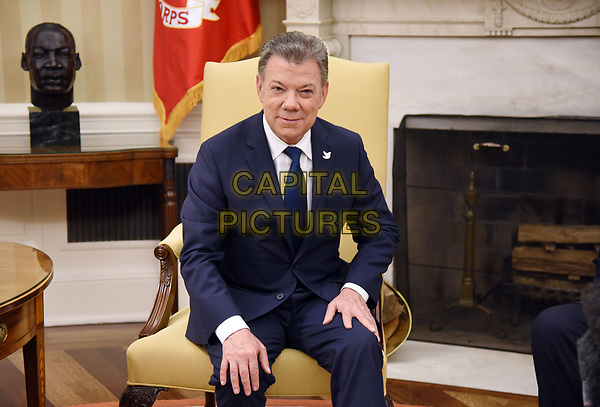 President Juan Manuel Santos of Colombia looks on during a meeting with United States President Donald J. Trump in the Oval Office of  the White House, on May 18, 2017 in Washington, DC. <br /> <br /> CAP/MPI/RS<br /> &copy;RS/MPI/Capital Pictures
