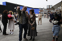 "NEW YORK - APRIL 13: Director Simon Cellan Jones, left, directs actress Aleksa Palladino, center, during filming of an episode of the new HBO series ""Boardwalk Empire"" on their Atlantic City Boardwalk set on Tuesday, April 13, 2010, in Brooklyn, New York.  The drama series, conceived by Terence Winter, an Emmy Award winning writer of The Sopranos, and Academy Award winning director Martin Scorcese, is set in Atlantic City during the dawn of prohibition, when the.sale of alcohol became illegal throughout the United States.(Photo by Landon Nordeman)"