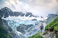 Trail running beneath glaciers on the way into the Strahlegghorn, from Grindelwald, Switzerland
