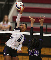 Arkansas Democrat-Gazette/STATON BREIDENTHAL --10/29/19-- Fayetteville's Rosana Hicks (left) hits the ball past Mount St. Mary defender Shailey Jackson Tuesday during their game in the 6A state Volleyball Tournament in Cabot. See more photos at arkansasonline.com/1030volleyball6A/.