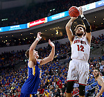 SIOUX FALLS, SD: MARCH 6: 	Trey Burch-Manning #12 from the University of South Dakota shoots a jumper over Reed Tellinghuisen #23 from South Dakota State University during the Summit League Basketball Championship on March 6, 2017 at the Denny Sanford Premier Center in Sioux Falls, SD. (Photo by Dave Eggen/Inertia)