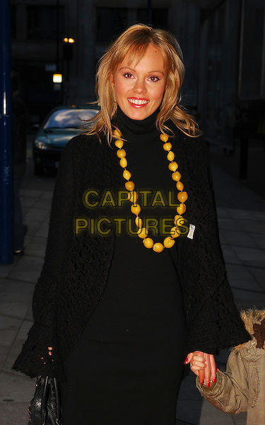 "MICHELLE DEWBERRY & GUEST.At ""The Snowman"" Press Night, .Peacock Theatre, London, England, .December 9th 2006..half length black coat yellow necklace beads.CAP/CAN.©Can Nguyen/Capital Pictures"