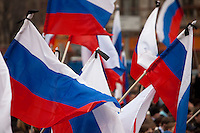 Moscow, Russia, 31/03/2010..Russian flags with black mourning ribbons at a government sponsored rally against terrorism, organised by a range of pro-Kremlin youth movements, two days after the suicide bombings that killed 39 and injured 82 on the Moscow metro system.