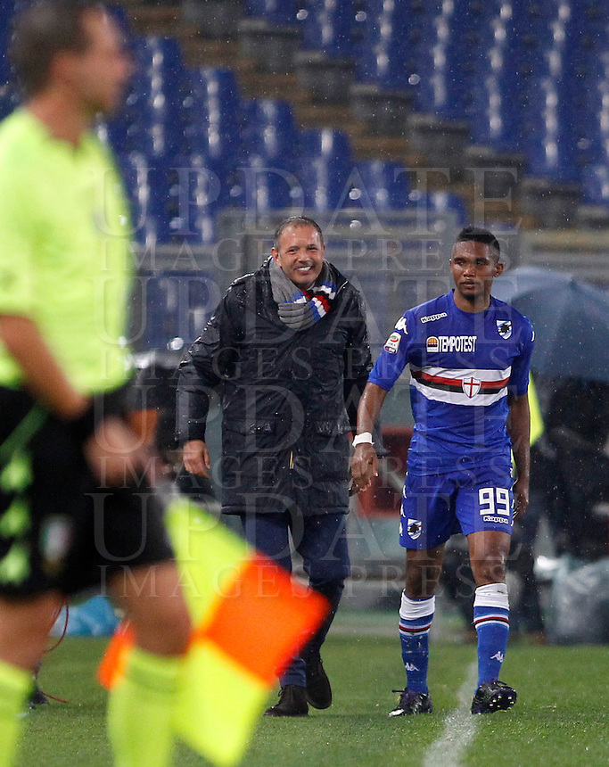 Calcio, Serie A: Roma vs Sampdoria. Roma, stadio Olimpico, 16 marzo 2015. <br /> Sampdoria&rsquo;s coach Sinisa Mihajlovic, center, smiles past his player Samuel Eto&rsquo;o, right, during the Italian Serie A football match between Roma and Sampdoria at Rome's Olympic stadium, 16 March 2015.<br /> UPDATE IMAGES PRESS/Isabella Bonotto