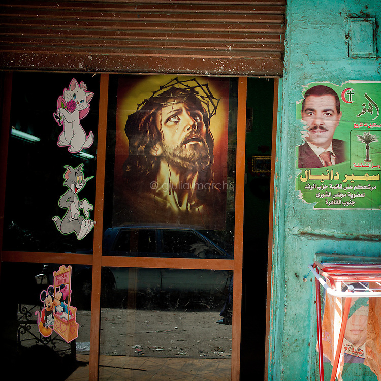 Egypt / Cairo / 22.3.2012 / Posters in the Coptic area of 'Garbage City', Moqattam district in Cairo. Here lives a minority Coptic religious community, the Zabbaleen, who have served as Cairo's informal rubbish collectors for the past decades. Egypt, March 2012.