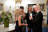 United States President Barack Obama and First Lady Michelle Obama talk with Vice President Joe Biden and Dr. Jill Biden in the Blue Room of the White House before the National Governors Association Dinner, February 24, 2013. .Mandatory Credit: Pete Souza - White House via CNP