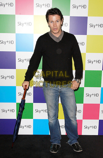 NICK MORAN.Sky+ HD Designer Box Launch Party at Il Bottaccio, London, England.  .August 14th 2008.full length black top jeans denim umbrella.CAP/ROS.©Steve Ross/Capital Pictures.