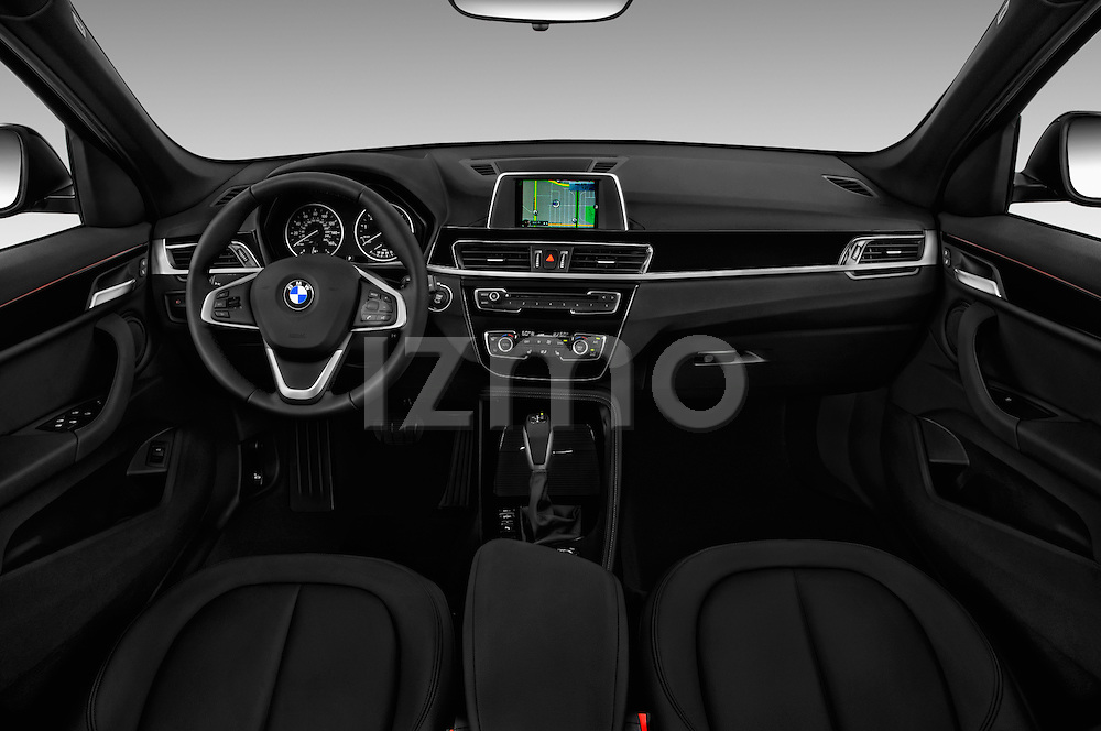 Stock photo of straight dashboard view of 2016 BMW X1 28i 5 Door Suv Dashboard