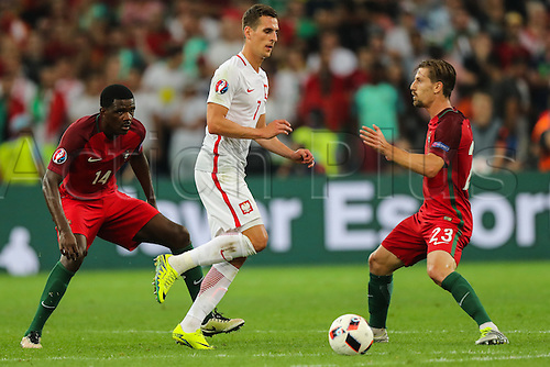 30.06.2016. Marseille, France. UEFA EURO 2016 quarter final match between Poland and Portugal at the Stade Velodrome in Marseille, France, 30 June 2016.   Arkadiusz Milik (POL) closed down by William Carvalho (POR)and  Adrien Silva (POR)