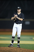 Wake Forest Demon Deacons relief pitcher Chris Farish (32) rubs up the baseball during the game against the Virginia Cavaliers at David F. Couch Ballpark on May 18, 2018 in  Winston-Salem, North Carolina.  The Cavaliers defeated the Demon Deacons 15-3.  (Brian Westerholt/Four Seam Images)