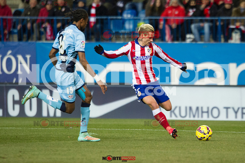 Atletico de Madrid&acute;s Antoine Griezmann and Rayo Vallecano&acute;s Abdoulaye Ba during 2014-15 La Liga match between Atletico de Madrid and Rayo Vallecano at Vicente Calderon stadium in Madrid, Spain. January 24, 2015. (ALTERPHOTOS/Luis Fernandez) /NortePhoto<br />