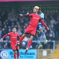Paul McCallum of Leyton Orient (10) and Aaron Pierre of Wycombe Wanderers  in an aerial battle during the Sky Bet League 2 match between Wycombe Wanderers and Leyton Orient at Adams Park, High Wycombe, England on 17 December 2016. Photo by David Horn / PRiME Media Images.