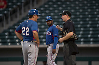 AZL Rangers first base coach Jeremy Moore (43) watches as manager Matt Siegel (22) argues a call made by home plate umpire Austin Nelson during an Arizona League game against the AZL Cubs 2 at Sloan Park on July 7, 2018 in Mesa, Arizona. AZL Rangers defeated AZL Cubs 2 11-2. (Zachary Lucy/Four Seam Images)