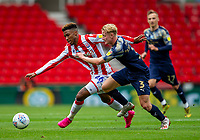 4th July 2020; Bet365 Stadium, Stoke, Staffordshire, England; English Championship Football, Stoke City versus Barnsley; Tyrese Campbell of Stoke City is tackled by Ben Williams of Barnsley