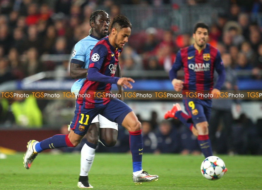 Neymar of FC Barcelona goes past Bacary Sagna of Manchester City - FC Barcelona vs Manchester City - European Champions League Round of Sixteen Football at the Camp Nou Stadium on  18/03/15 - MANDATORY CREDIT: Dave Simpson/TGSPHOTO - Self billing applies where appropriate - 0845 094 6026 - contact@tgsphoto.co.uk - NO UNPAID USE