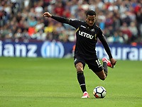 Matrin Olsson of Swansea City crosses the ball during the Premier League match between West Ham United v Swansea City at the London Stadium, London, England, UK. Saturday 30 September 2017