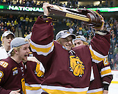 Mike Connolly (Duluth - 22), Kenny Reiter (Duluth - 35) - The University of Minnesota-Duluth Bulldogs celebrated their 2011 D1 National Championship win on Saturday, April 9, 2011, at the Xcel Energy Center in St. Paul, Minnesota.