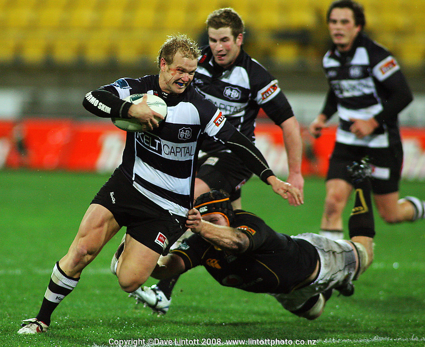 Jason Shoemark tries to escape the diving tackle of Thomas Waldrom during the Air NZ Cup match between Wellington and Hawkes Bay at Westpac Stadium, Wellington, New Zealand on Friday, 1 August 2008. Photo: Dave Lintott / lintottphoto.co.nz