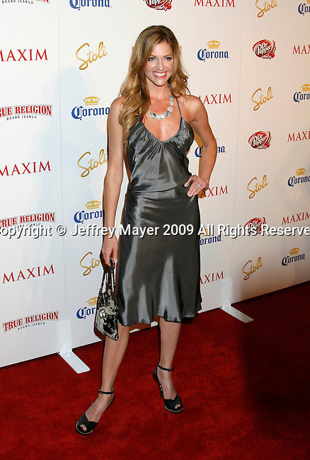 SANTA MONICA, CA. - May 13: Tricia Helfer arrives at the Maxim's 10th Annual Hot 100 Celebration at The Barker Hangar on May 13, 2009 in Santa Monica, California.