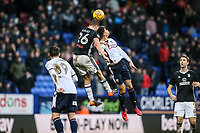 Bolton Wanderers' Tyler Walker competing in the air with Fulham's Tomas Kalas<br /> <br /> Photographer Andrew Kearns/CameraSport<br /> <br /> The EFL Sky Bet Championship - Bolton Wanderers v Fulham - Saturday 10th February 2018 - Macron Stadium - Bolton<br /> <br /> World Copyright &copy; 2018 CameraSport. All rights reserved. 43 Linden Ave. Countesthorpe. Leicester. England. LE8 5PG - Tel: +44 (0) 116 277 4147 - admin@camerasport.com - www.camerasport.com