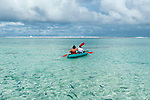 Couple canoeing in lagoon in Rarotonga, Cook Islands