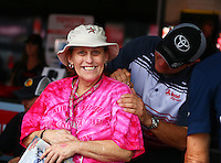 Apr 25, 2015; Baytown, TX, USA; A fan reacts as NHRA funny car driver Chad Head autographs her shirt during qualifying for the Spring Nationals at Royal Purple Raceway. Mandatory Credit: Mark J. Rebilas-