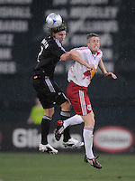 DC United defender Gonzalo Peralta (2) jumps to head the ball against New York Red Bulls forward John Wolyniec (15),DC United defeated The New York Red Bulls 4-1, at RFK Stadium in Washington DC, Saturday June 14, 2008.